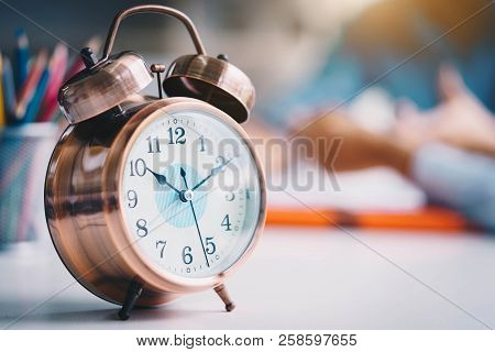 Alarm Clock On White Table.time Management And Punctuality At Work Concept.punctuality Management.