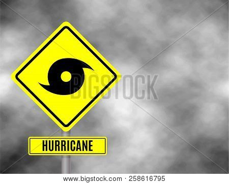 Hurricane Sign Road. Yellow Hazard Warning Sign Against Grey Sky - Tornado Warning, Bad Weather Warn