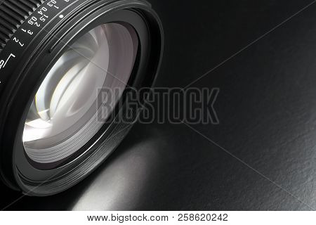 Dslr Camera Lens On Black Surface Closeup