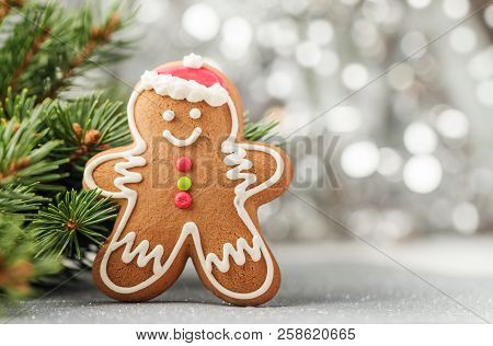 Christmas Decorations With Gingerbread Man, Fir Tree Branches And Christmas Baubles Background