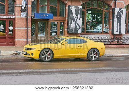 Krasnoyarsk, Russia - September 13, 2018: Chevrolet Camaro Yellow Color. The Car Is Parked Near Shop
