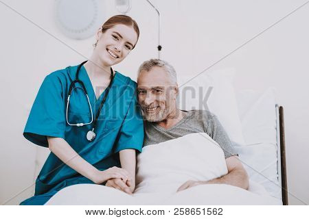 Stethoscope Help Patient. Nurse With Patient. Nurse Help Patient In Clinic. Rehabilitation In Clinic