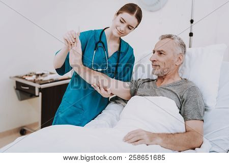 Sick Old Man In Clinic. Rehabilitation For Sick Patient. Rehabilitation With Nurse In Hospital. Chir