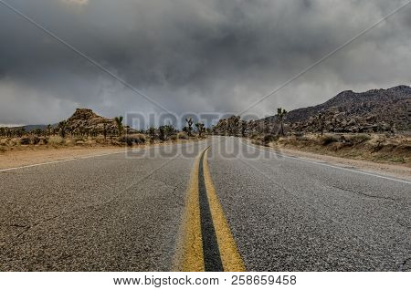 Middle Of Desert Road Just Before A Storm Rolls In On A Wintery Day During El Nino