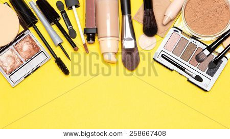 Day Makeup Set. Beauty Products For Natural Make Up Top View On Yellow Background With Copy Space