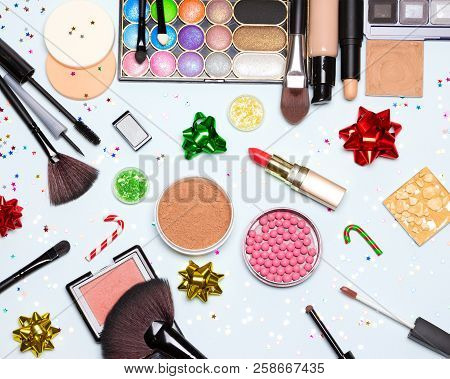 Christmas Party Glistening Makeup. Bright Sparkling New Year Make-up. Top View, Flat Lay
