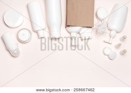 Cosmetic Products With Paper Packaging Bag. Buying Cosmetics, Beauty Shopping Background. Top View,