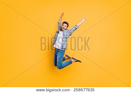 Full-size Portrait Of Happy Excited Young Man Screaming And Jumping Up With Raised Fists Celebrate T