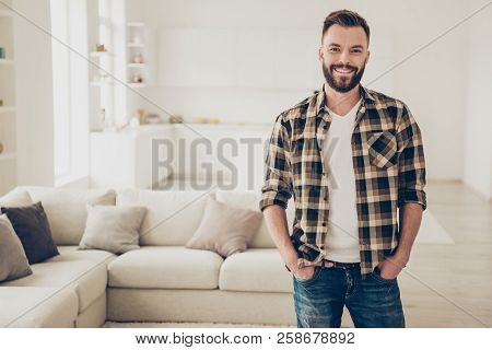 Good-looking, Carefree, Careless Man Stands In The Middle Of The Room And Joyfully Looks Into The Ca