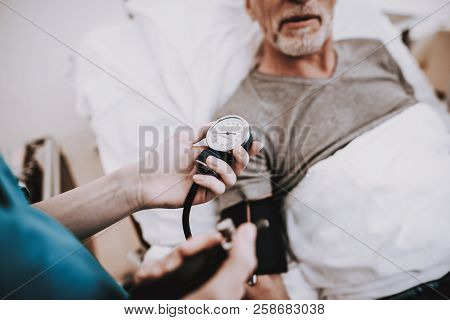 Old Man With Nurse In Hostital. Young Nurse With Patient. Nurse And Doktor In Clinic. Nurse With Pat