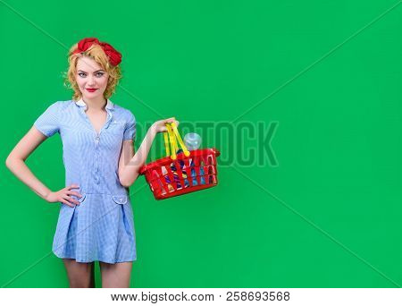 Woman Buys Products In Supermarket. Pin Up Girl On Shopping. Woman With Basket In Shop. Retro Style.