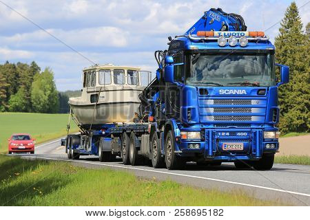 Salo, Finland - May 31, 2015: Scania 124 Hauls A Recreational Boat On A Drop Deck Trailer. The Finni