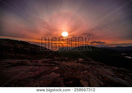 Sunrise On Preikestolen Over Lysefjorden, Norway, A Stunning Landscape And Beautiful Fjords