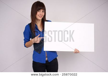 Happy woman pointing at the blank board.