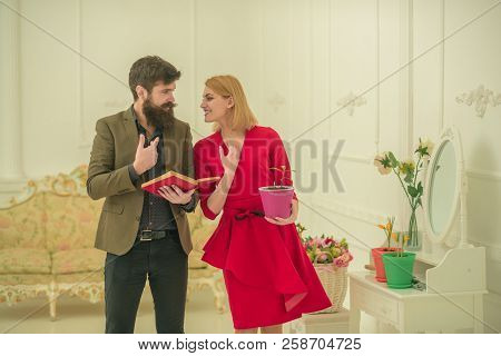 Family Concept. Family Learning About Gardening At Home. Bearded Man Help Sensual Woman To Care For