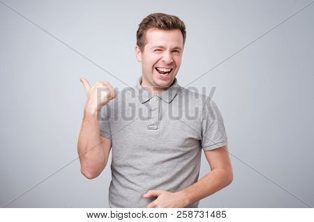Happy Caucasian Handsome Man Showing Thumbs Up