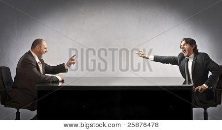 Two businessmen quarreling