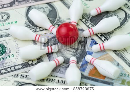 Financial Success Target Concept, Red Winning Bowling Strike Ball Surround With Knocked Down Pins On