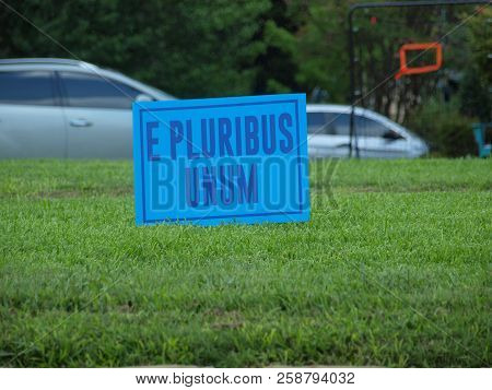An Unusual Yard Sign But The Color Is More Unusual Than The Words On The Sign. Out Of Many, One.