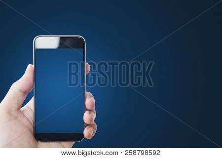 Hand Holding Mobile Smart Phone, Blank Blue Screen, On Gradient Blue Background