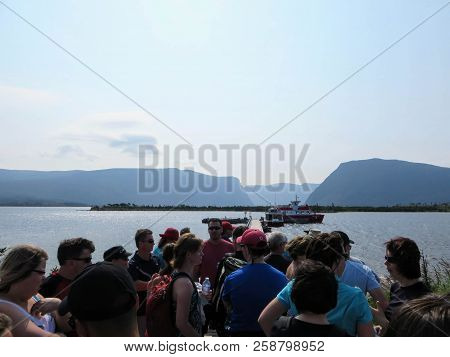 Western Brook Pond, Newfoundland, Canada - July 22nd, 2014:  A Crowd Of Tourists Waiting For The Tou