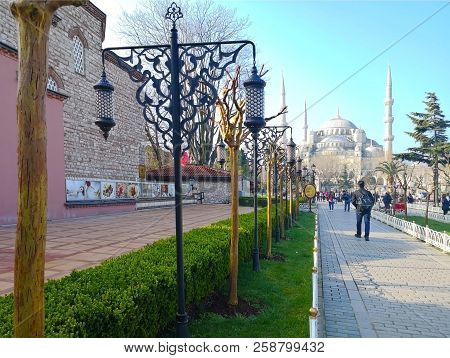 The Central Park Of Istanbul, Turkey-march 30, 2018: The Walkway In The Public Park Has Black Pillar