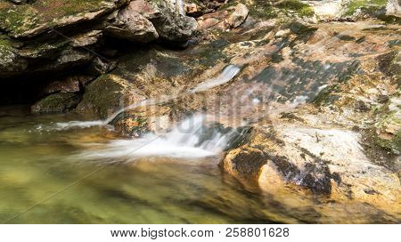 Peaceful waterfall on a rock covered with moss (Regional Park of the Massif du Sud in Quebec, Canada). - Slow Shutter Photo poster