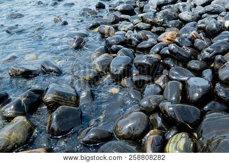 Beautiful Wet Black Stones At Koh Hin Ngam In Summer Time Concept Travel, Holiday And Vacation. Trop