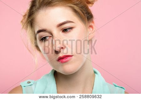 Facial Expression. Mood And Emotion. Bored Apathetic Indifferent Woman Looking Down. Young Beautiful