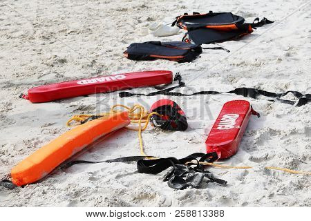 Medical Emergency Tool Bag Or First Aid Kit On The Beach With People Who Rescue And Cpr Training Or