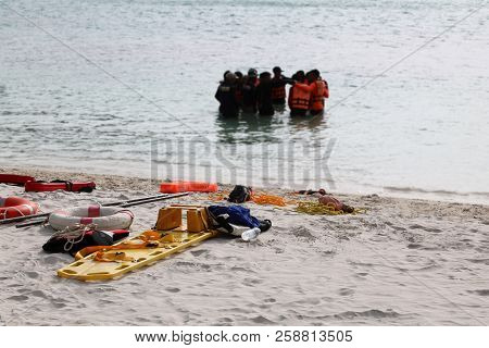 Edical Emergency Tool Bag Or First Aid Kit On The Beach With People Who Rescue And Cpr Training Or P