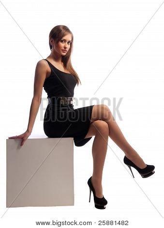 Woman Sitting On Wooden Cubes
