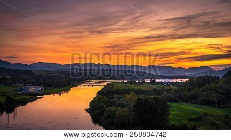 Colorful Sunset Over The River Vah And The Western Tatras Mountains In Liptov Region, Slovakia