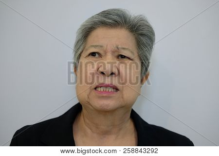 Furious Elder Woman, Enraged Elderly Female. Angry Asian Senior