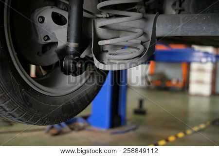 Damaged Rear Car Shock Absorber & Spring In Auto Repair Garage