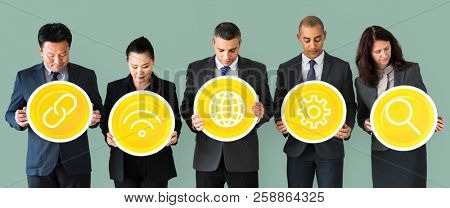 Business people holding internet icons