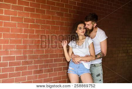 Pure Feelings. Couple In Love Hugs Brick Wall Background. Couple Find Place To Enjoy Feelings. Girl