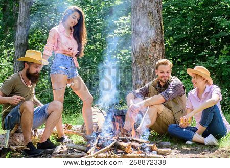 Pleasant weekend near campfire. Friends enjoy summer vacation or weekend forest. Company friends relaxing near campfire. Summer vacation. Best friends spend leisure weekend forest nature background poster