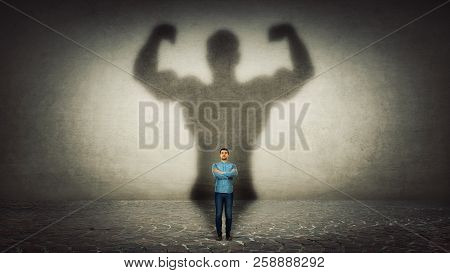 Confident Businessman Imagine Himself A Powerful Hero, Casting Shadow Of Big Strong Muscular Bodybui
