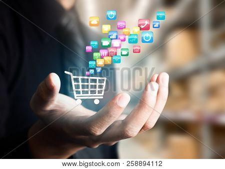Businessman Hand Show Mobile Application Icon With Shopping Cart