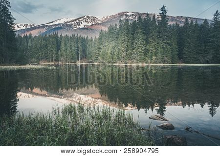 Vintage Style Photo Of Misty Mountain Lake