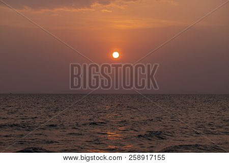 Orange Sunset Landscape With Sea And Red Sun. Red Orange Sunset Sky. Romantic Evening Seascape With