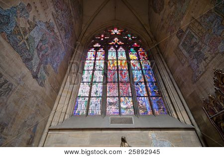 Gothic stained-glass window in St. Vitus Cathedral, interior, Prague.