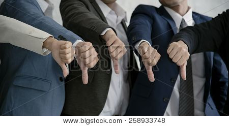 Group Businesspeople Thumbs Down Together. Concept Rejection And Boycott.