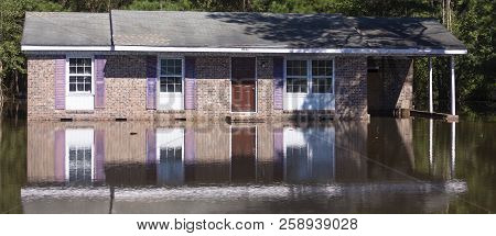 Wagram, North Carolina, United States/september 18, 2018: Flood Waters Backing Up On A Bridge Just S
