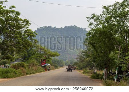 Siem Reap, Cambodia - 29 March 2018: Countryside Road With Green Roadside And Cambodian Transport. A