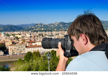 Young man taking an image of Florence, Italy