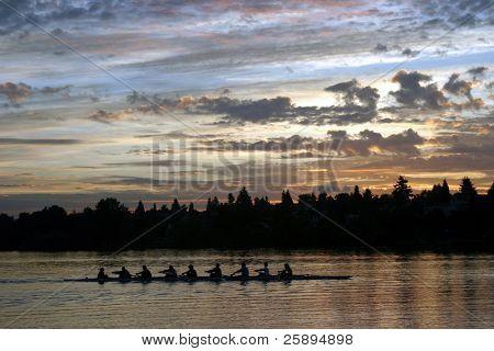 people rowing on green lake at sunrise in seattle washington