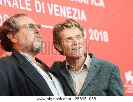 Julian Schnabel and Willem Dafoe attend 'At Eternity's Gate' photocall during the 75th Venice Film Festival at Sala Casino on September 3, 2018 in Venice, Italy.
