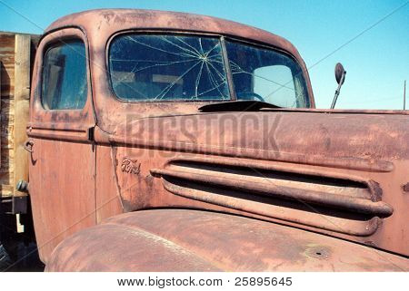 an old rusty truck sits in the blast furnice of the arizona sun in the summer reminding us of what was once was is now faded and gone but not forgotten